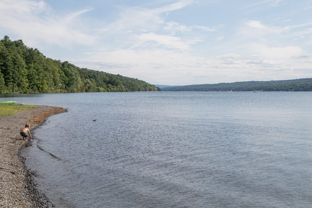 A boy plays along the edge of Keuka Lake in the Finger Lakes Region in upstate New York.