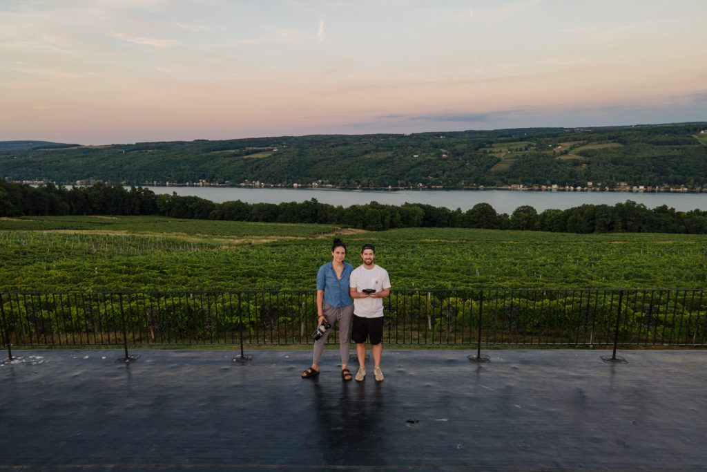 A man and a woman with Keuka Lake behind them.