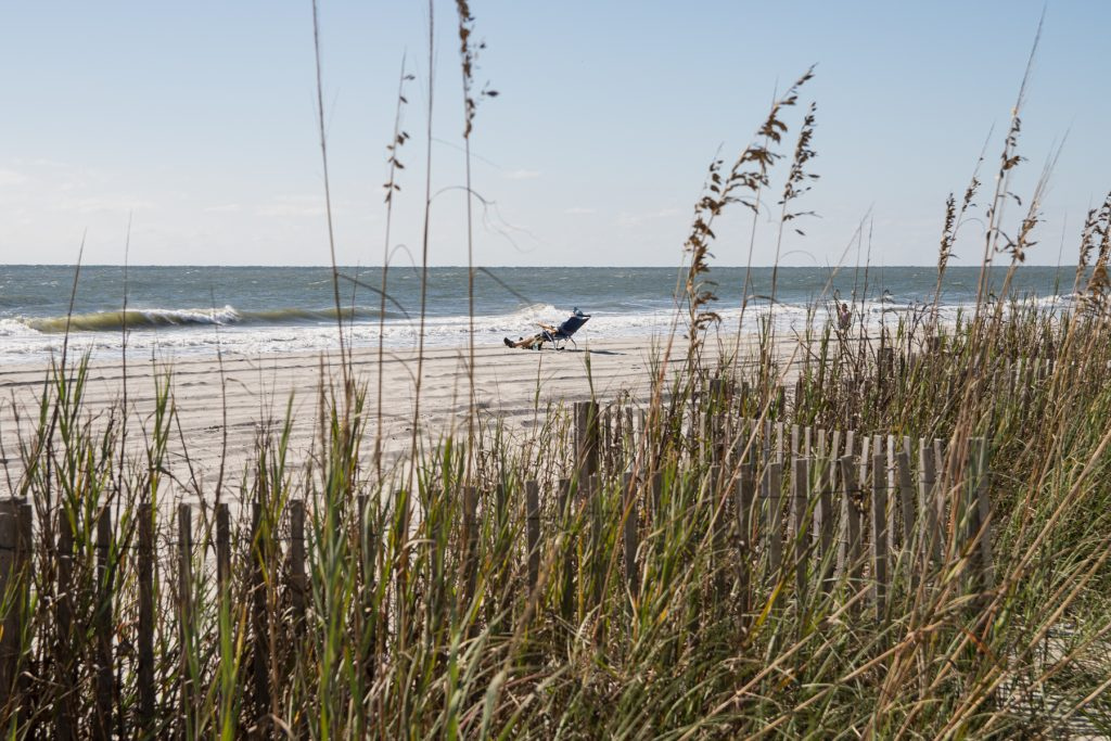A man laying out on the beach looking out to the Atlantic ocean in Myrtle Beach, South Carolina.