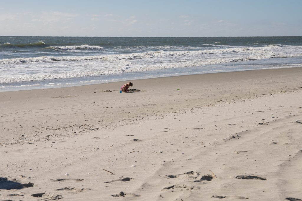 A chid playing in the sand in Myrtle Beach, South Carolina.