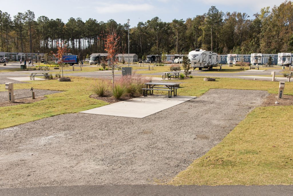 An example of a back-in gravel RV site at Carolina Pines Resort in Conway, South Carolina.