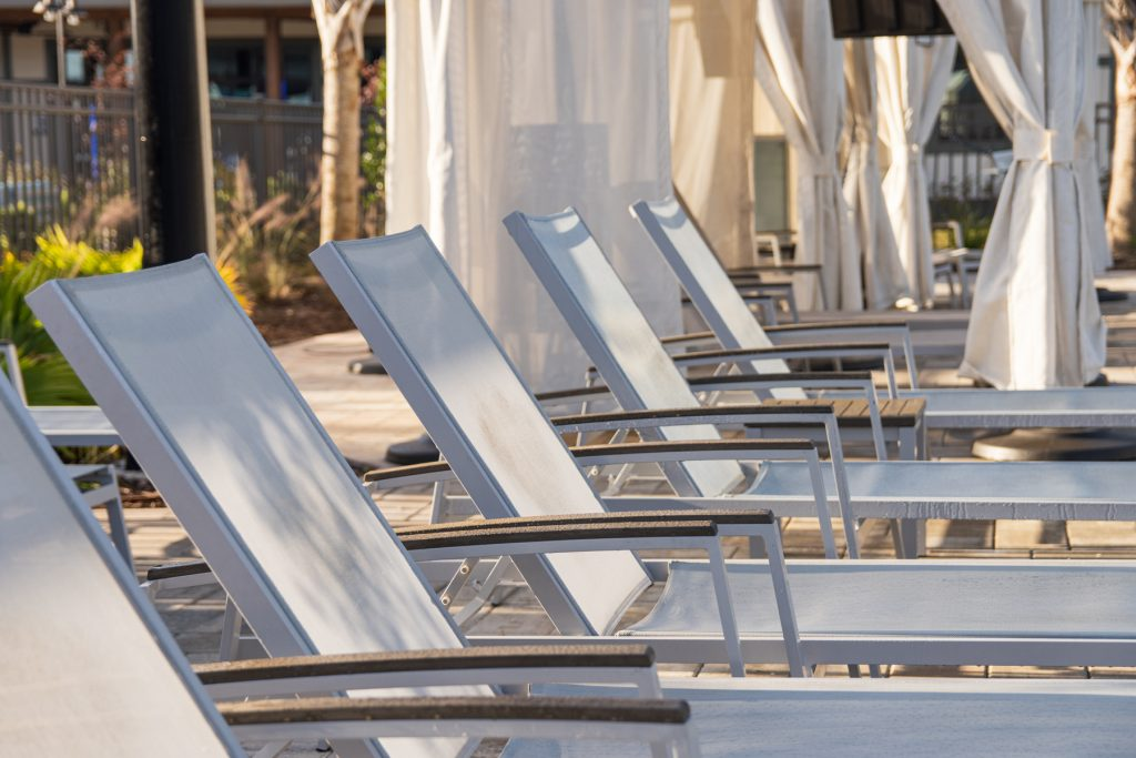 Lounge chairs lined up at the serenity pool at Carolina Pines Resort in Conway, South Carolina.