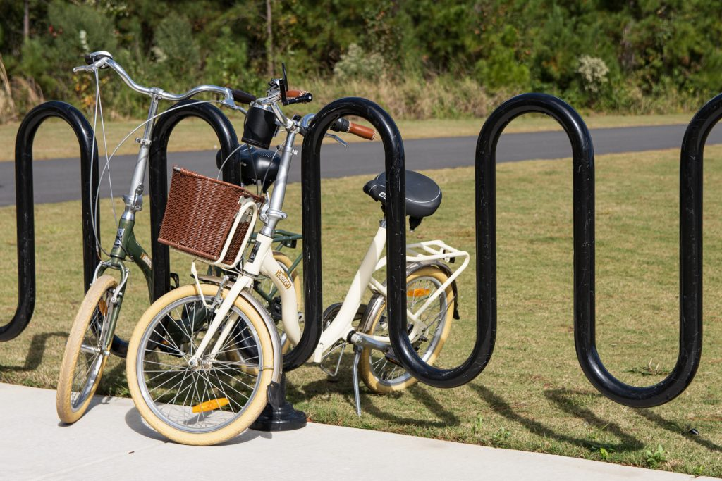 Two bicycles leaned up against a bike rack outside of the Carolina Commons at the Carolina Pines Resort in Conway, South Carolina.