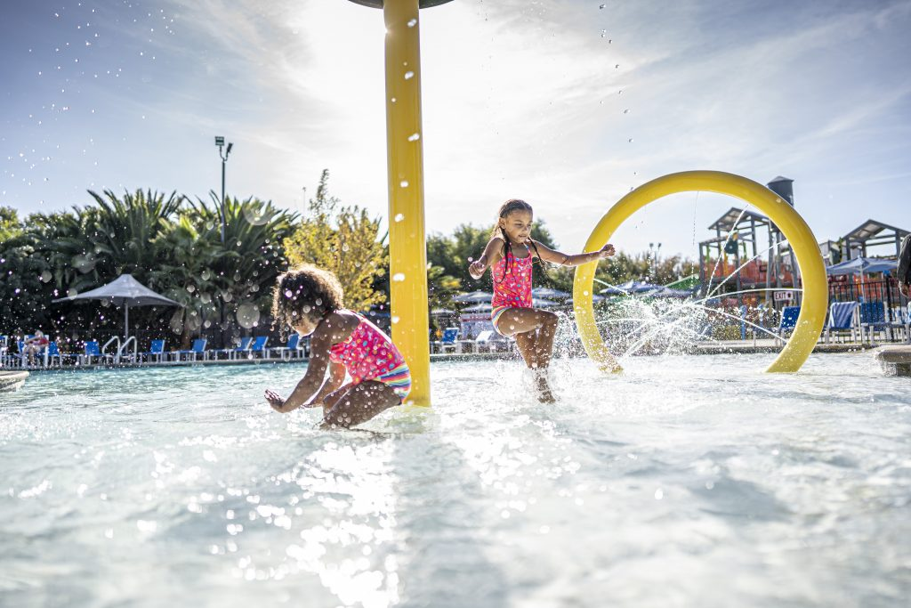 Children playing in the water park at Jellystone Campground in Lodi, CA.