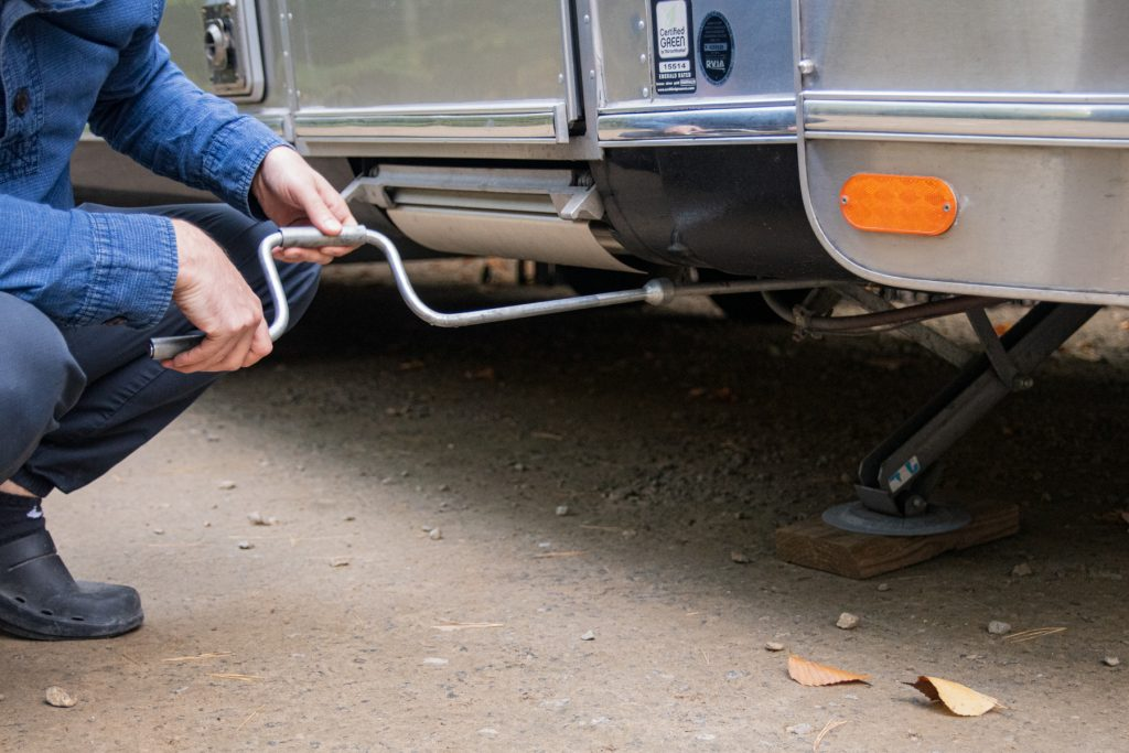 A man puts down the stabilizers of his RV.