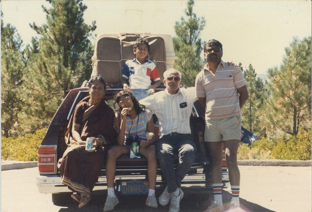 An old photo of a family ready to embark on a road trip.