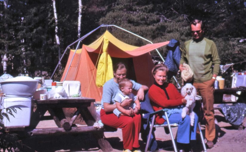 An image of a family in the 1970s camping.