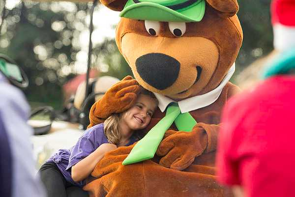 Yogi bear hugging girl at Yogi Bear's Jellystone Park™ Camp-Resort: Fredericksburg in Fredericksburg, TX