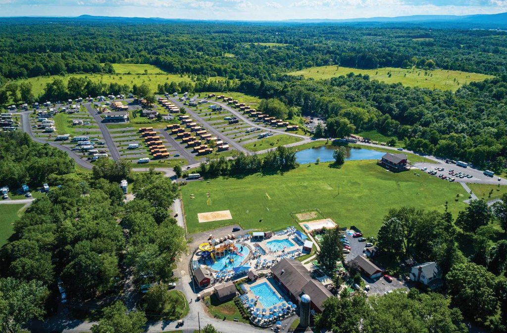 Image shot from above of waterpark, campground, RVs, forrest and mountains at Yogi Bear's Jellystone Park™ Camp-Resort: Gardiner in Gardiner, NY