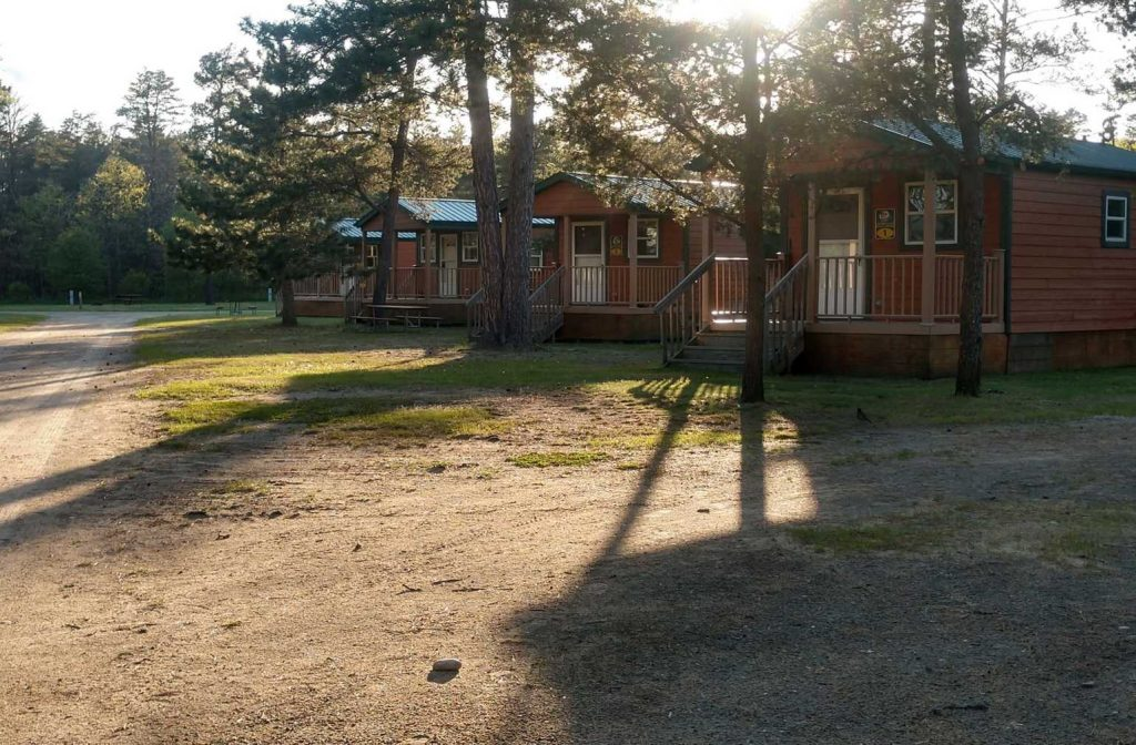 Cabins in the woods at Yogi Bear's Jellystone Park™ Camp-Resort: Grayling in Grayling, MI
