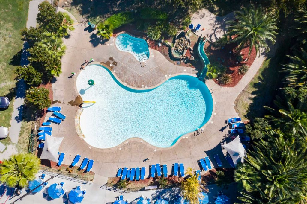 Pool area with beach chairs at Yogi Bear's Jellystone Park™ Camp-Resort: Tower Park in Lodi, CA
