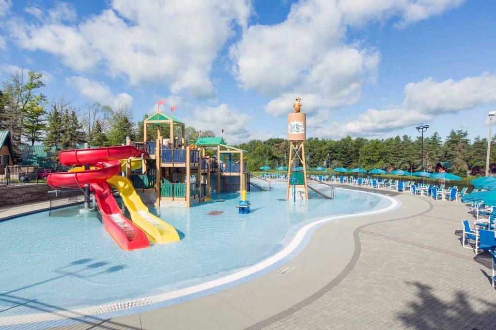 Pool with waterslides at Yogi Bear's Jellystone Park™ Camp-Resort: Western New York in North Java, NY
