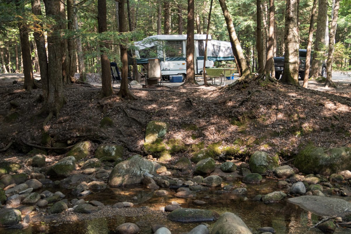 A pop-up camper sits along a brookside campsite at Lost River Valley Family Campground in North Woodstock, New Hampshire.