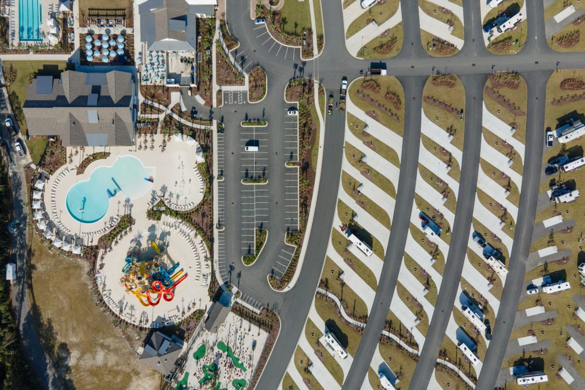An aerial view of Carolina Pines Resort in Conway, South Carolina. RV sites, a mini golf course, a waterpark, and more can be seen from above.
