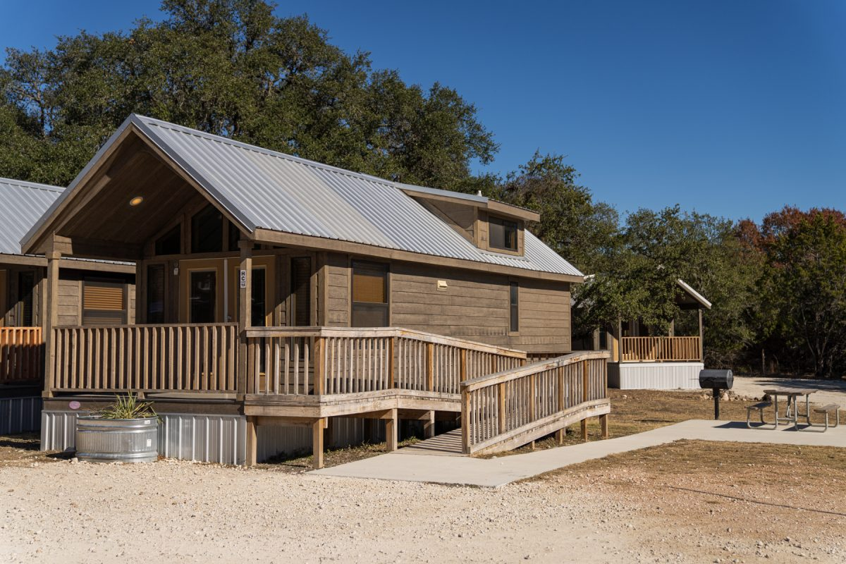 An ADA-compliant cabin available to rent at Jellystone Park Camp Resort: Hill Country in Canyonland, Texas.
