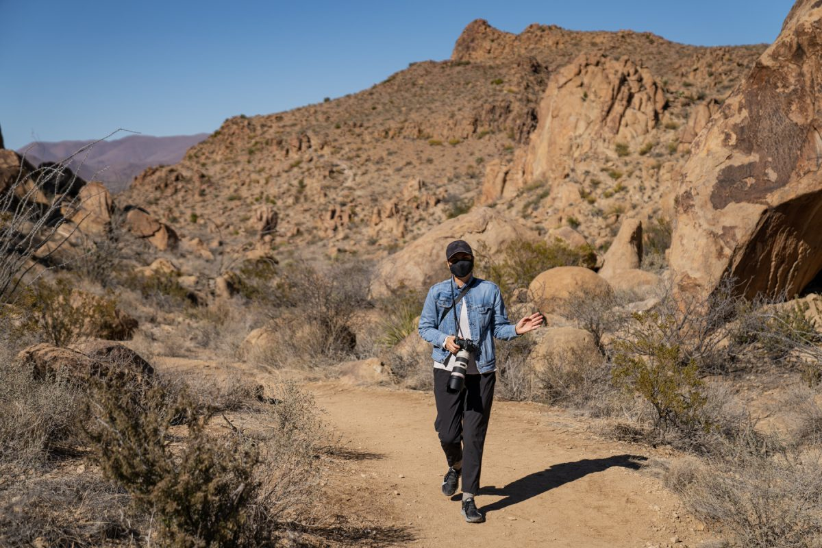 A woman hikes in Big Bend National Park wearing a mask to prevent the spread of the coronavirus.