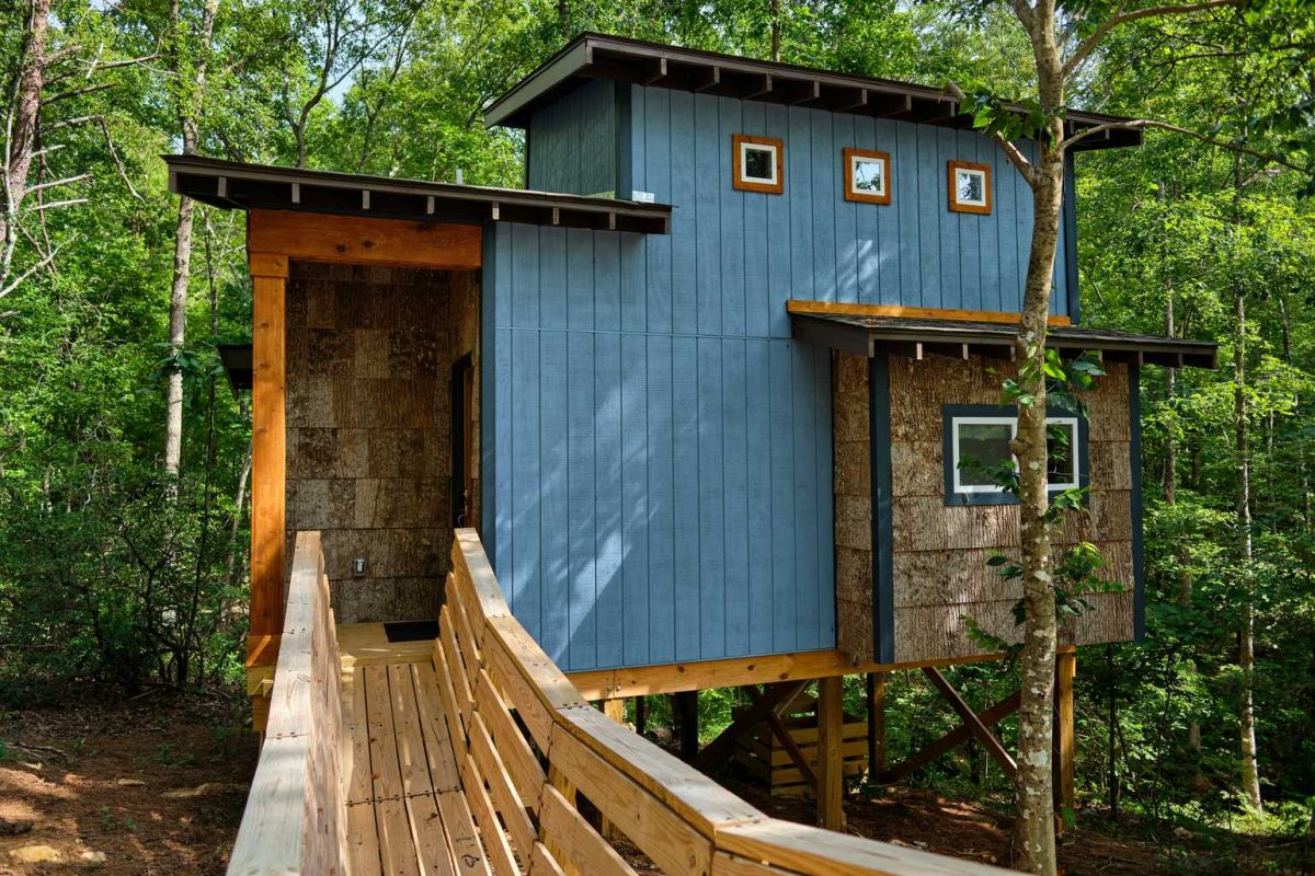 Blue treehouse in the woods at Emberglow in North Carolina.