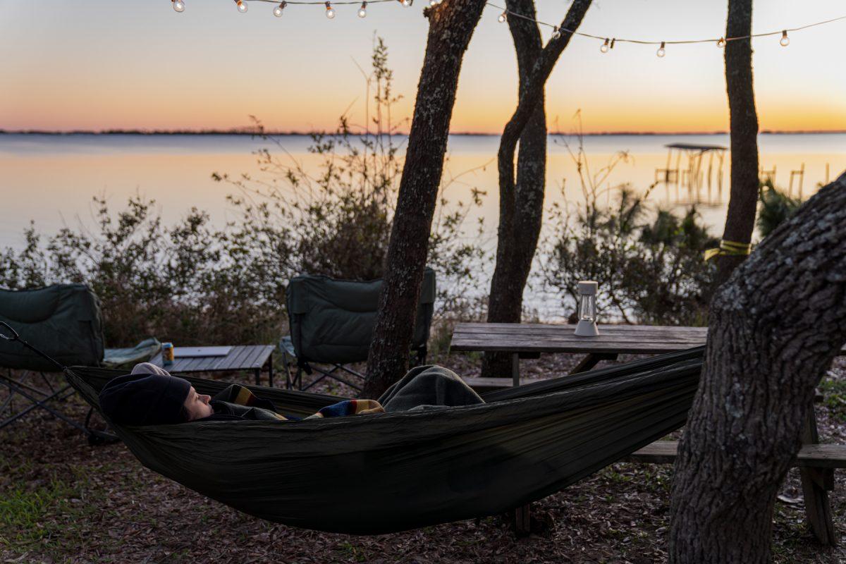 Campspot Ambassador Kendra in a hammock at he Hideaway Retreat in Navarre, FL