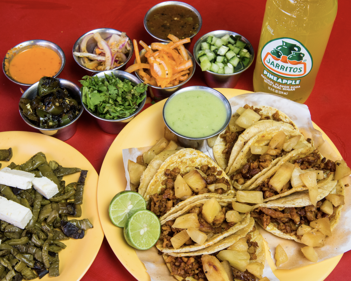 Tacos with toppings and pineapple drink