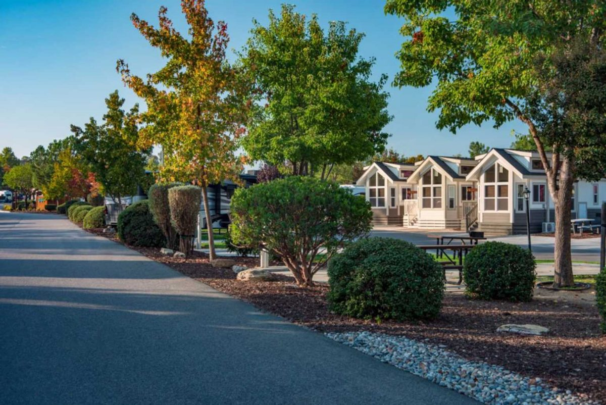 Cottages behind trees at Wine Country RV Resort