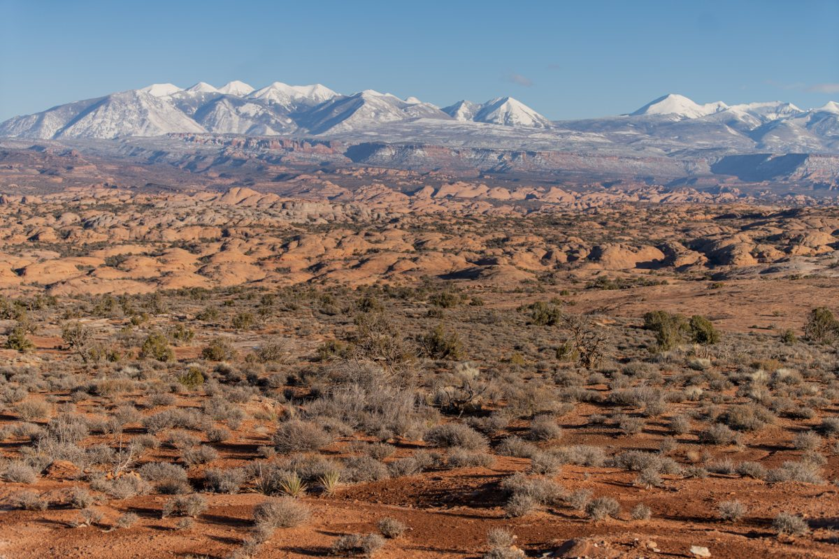 Arches National Park petrified sand dunes are seen in front of the La Sal mountain range in Moab, Utah.