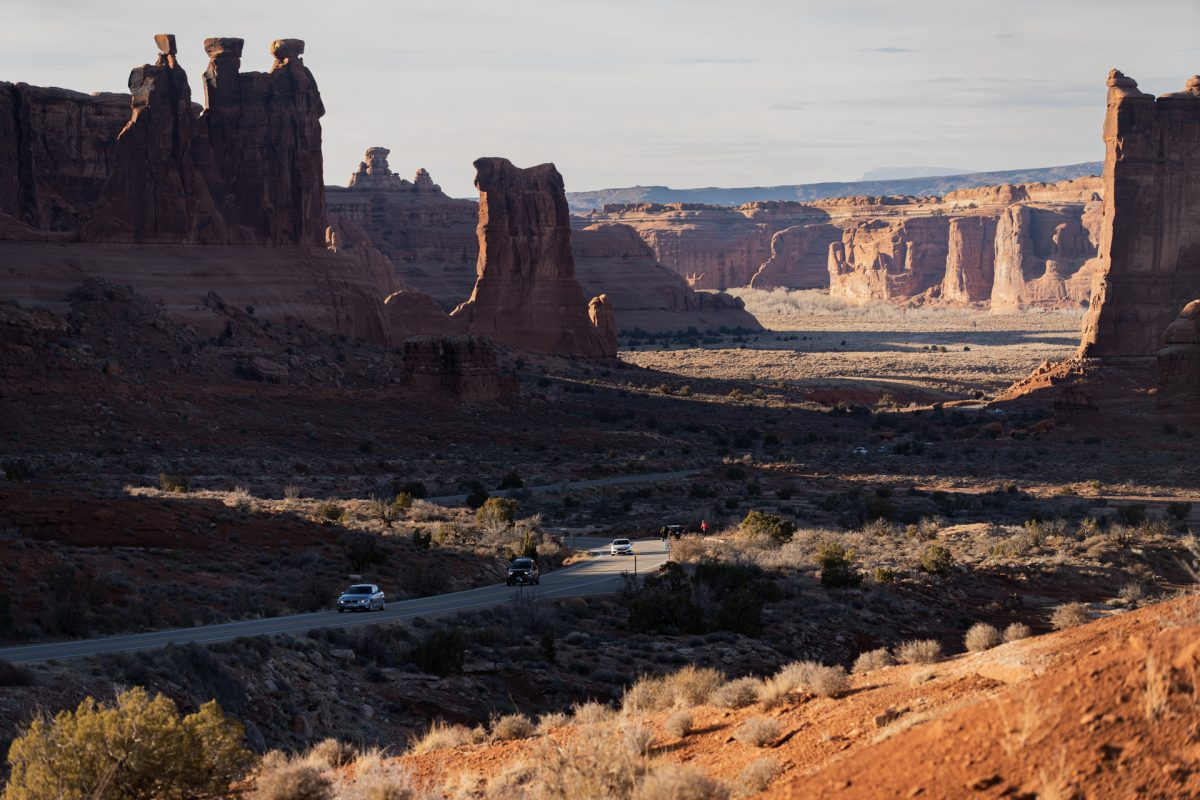 Red rock formations and fins cast shadows across Arches National Park in Moab, Utah.