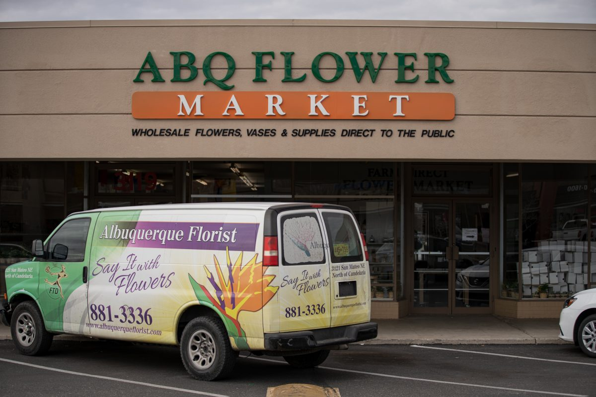 Storefront of the Albuquerque Flower Market in Albuquerque, New Mexico. The store's van sits in front of the shop.