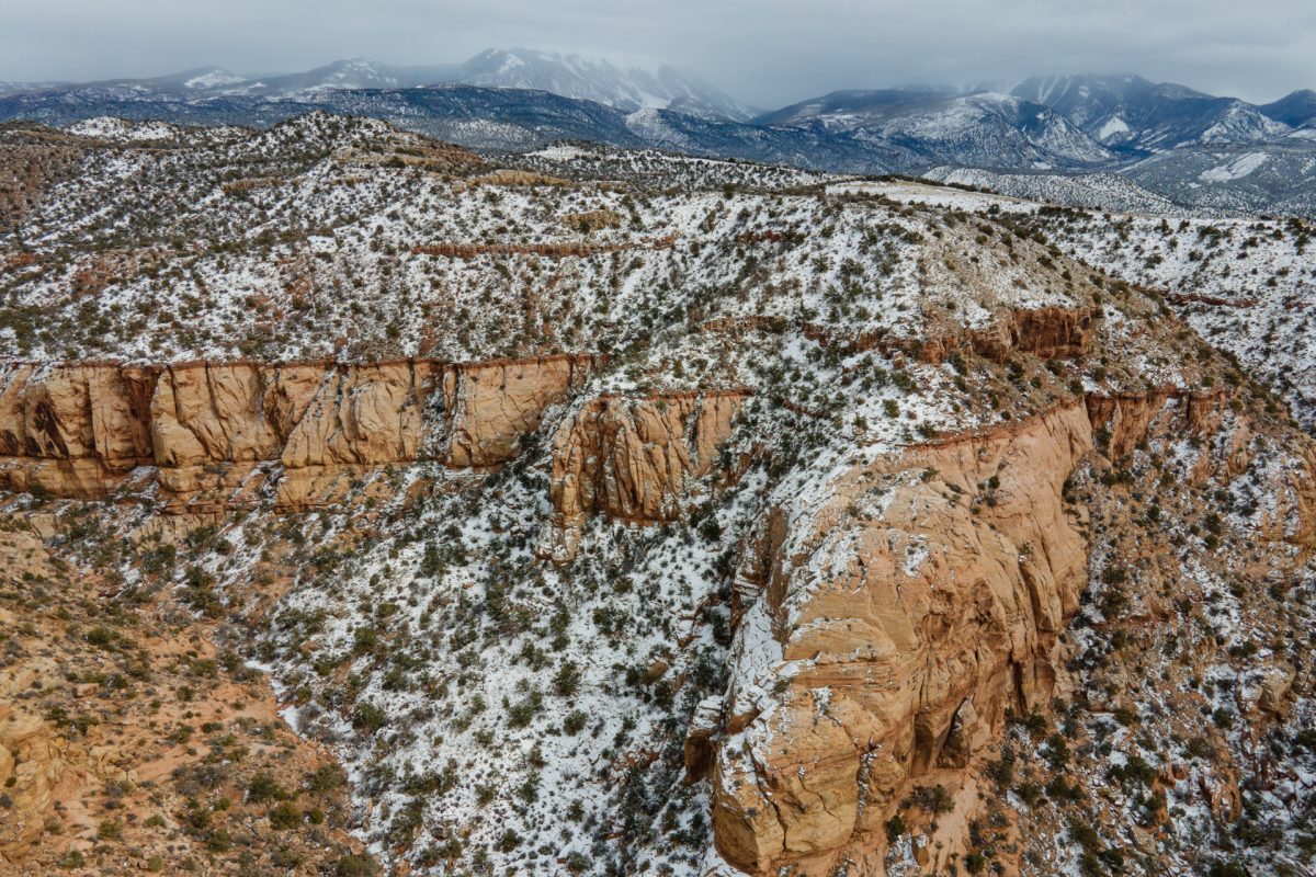 Snow covers the redrock with the La Sal Mountains in the back near Moab, Utah.