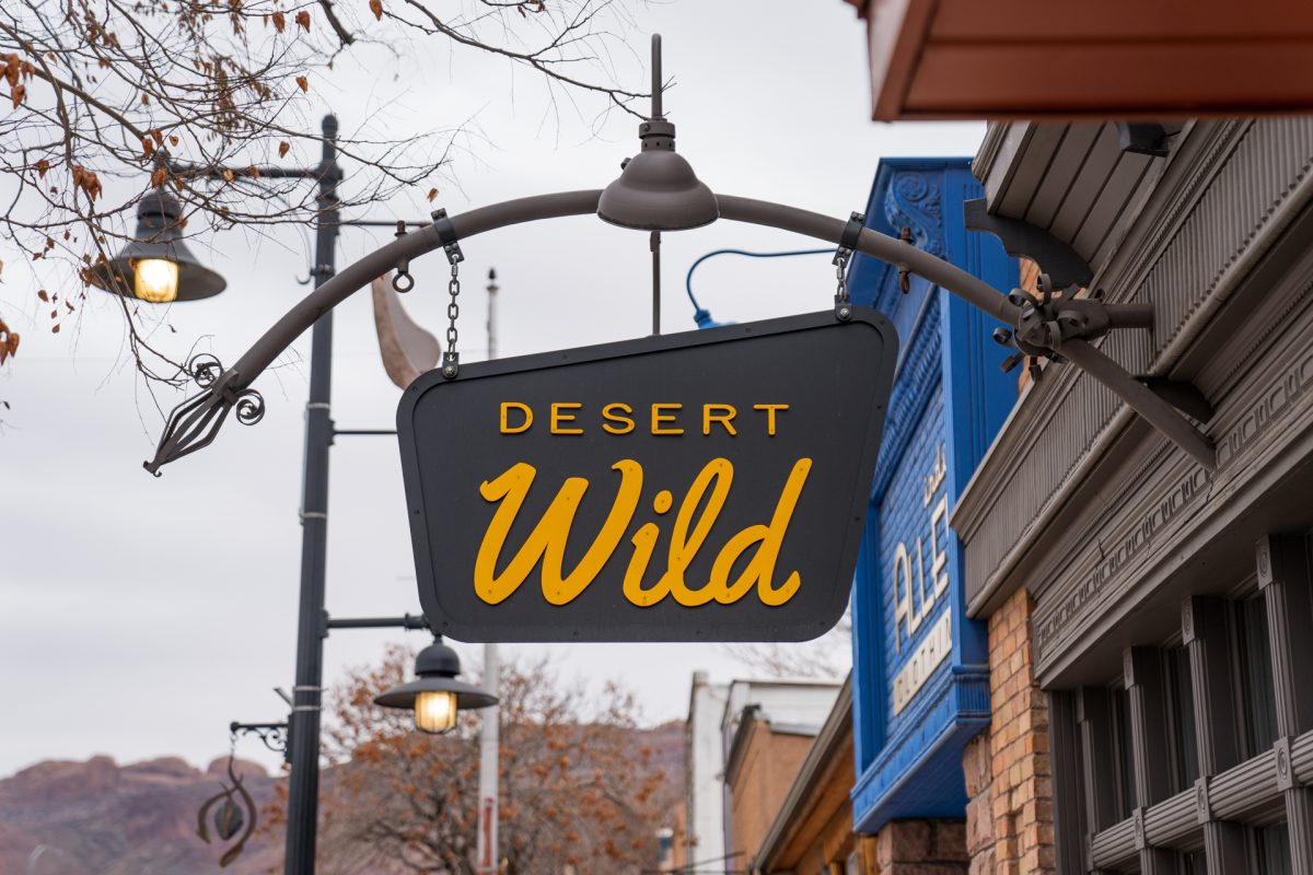 The store sign of the Desert Wild shop located in Moab, Utah.