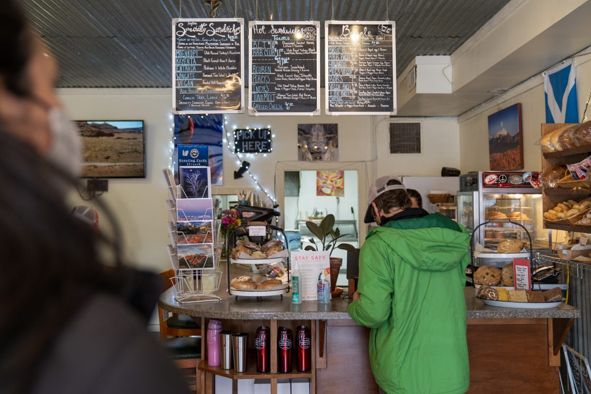 A person waits in line while someone is ordering food at the Redrock Bakery and Cafe in Moab, Utah.