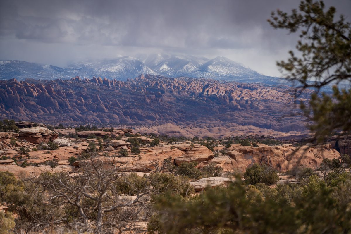 A stormy image of the La Sal Mountains from the Gemini Bridges in Moab, Utah.