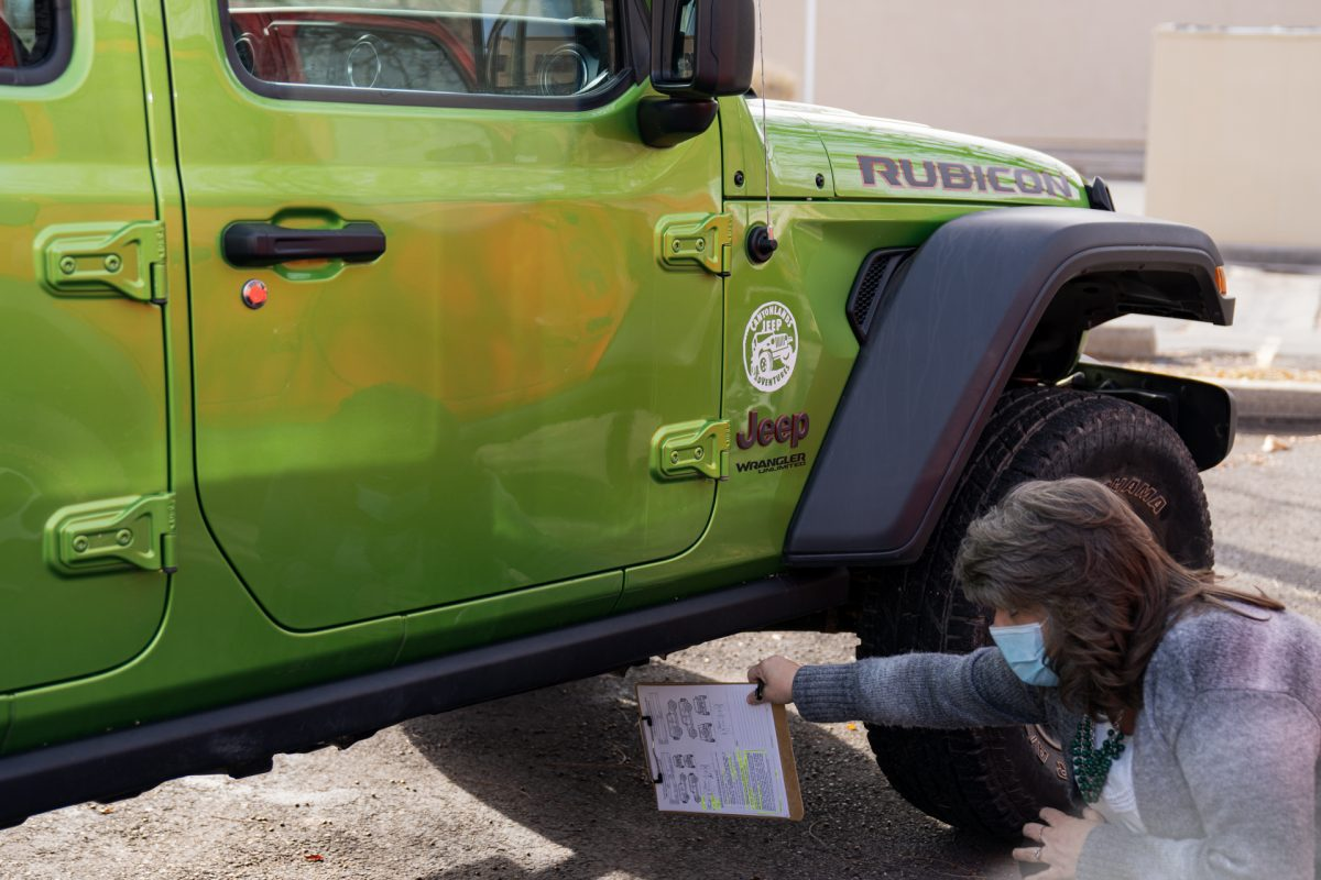 An employee from Canyonlands Jeep Rental in Moab, Utah, goes through the ins and outs of a jeep rental.