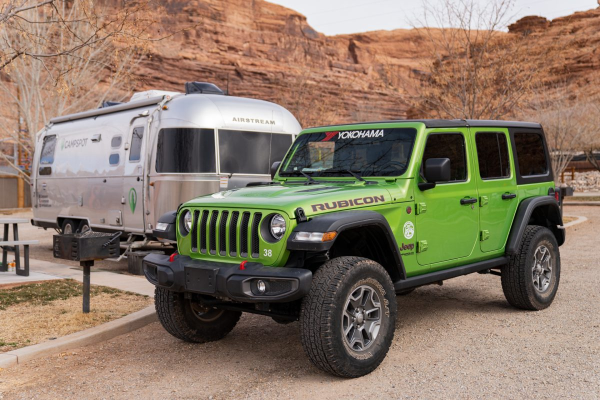 A green jeep sits in front of an Airstream trailer at the Moab Valley RV Resort and Campground in Moab, Utah.