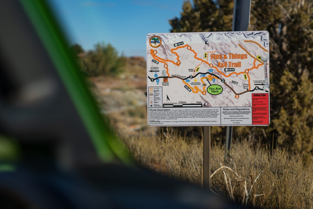 The sign of Fins & Things OHV trail in Moab, Utah.