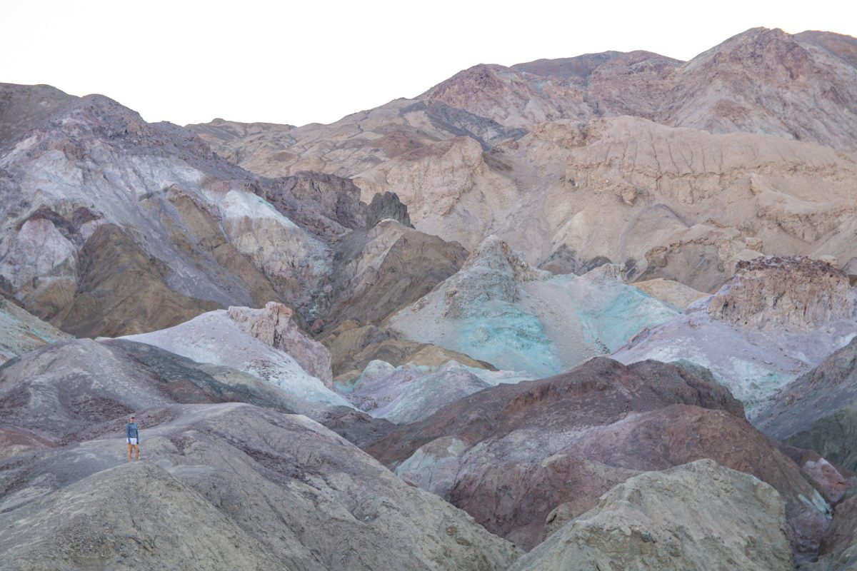 A woman stands in the Artist's Palette in Death Valley National Park in California.