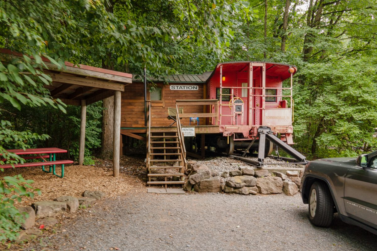 Train Caboose glamping lodge in the woods at Lake in Wood RV Resort