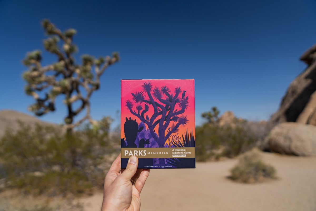 A person holds up the Keymaster PARKS Memories: Plains Walker Set in Joshua Tree National Park in California.