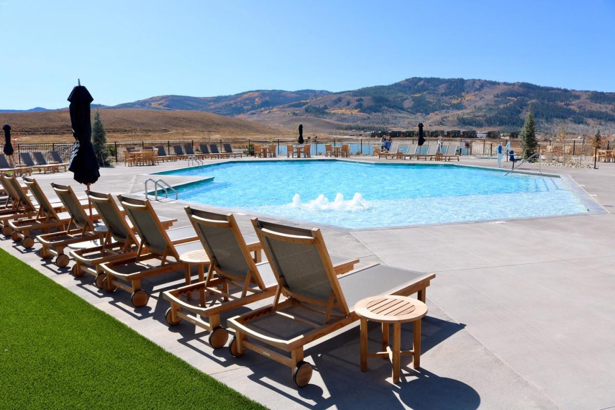 Outdoor pool at River Run RV Resort with mountain views