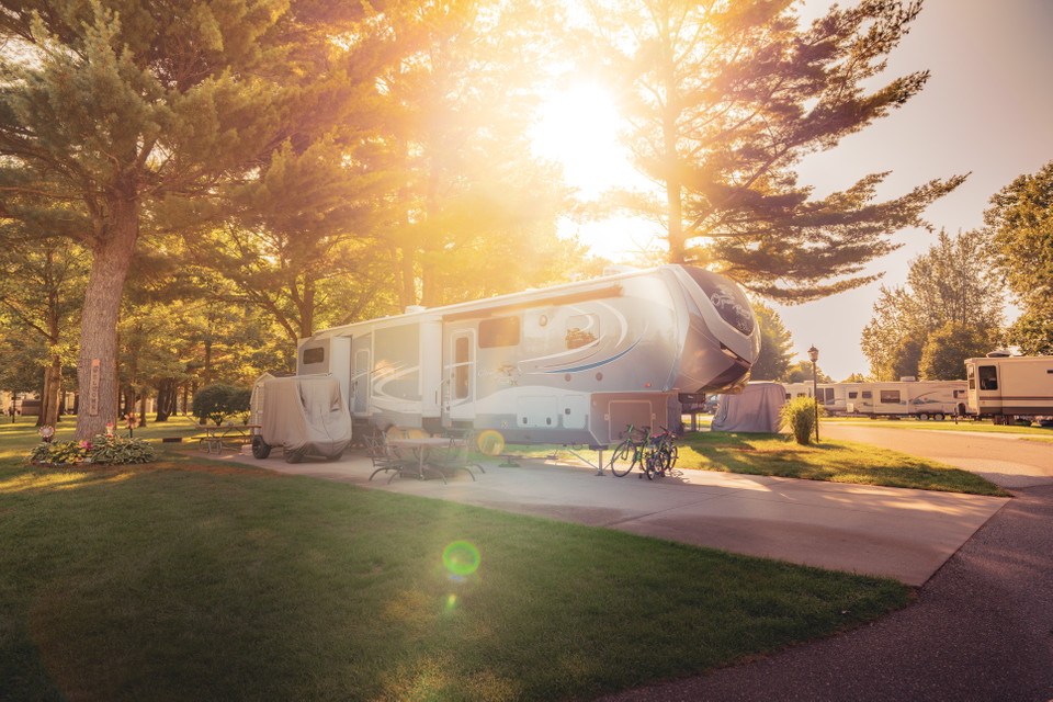 RV parked at Silver Creek RV Resort as the sun is setting.