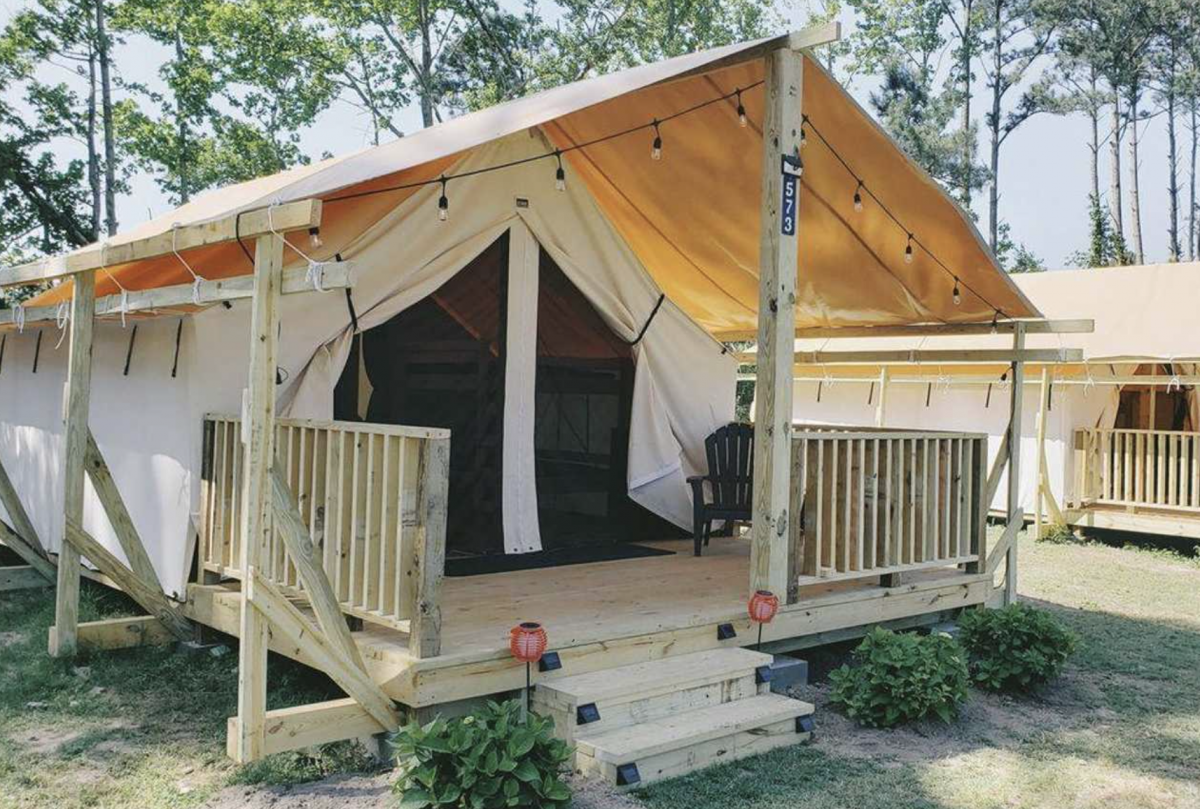 Glamping tent with lights and porch at Lovers Way in West Virginia.