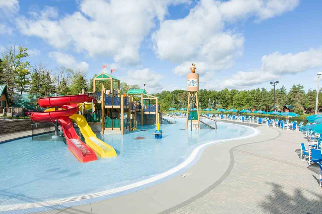 Pool and Water Zone with water slides at Yogi Bear's Jellystone Park Camp-Resort in Western New York.