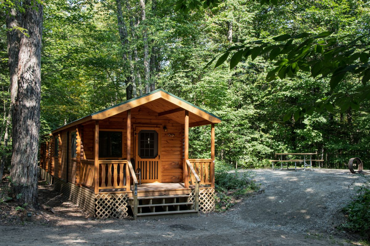 Cabin camping in the woods at Lost River in New Hampshire.