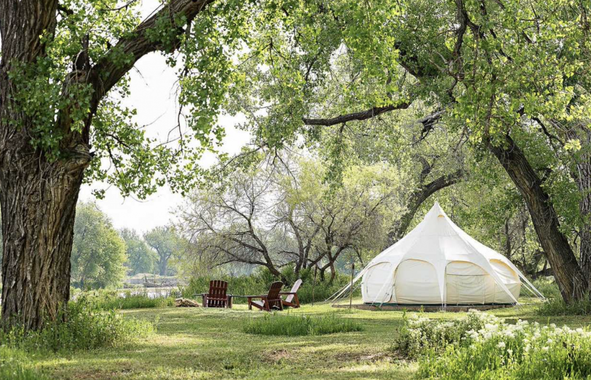 Canvas tent with fire pit at Platte River Fortcampground.