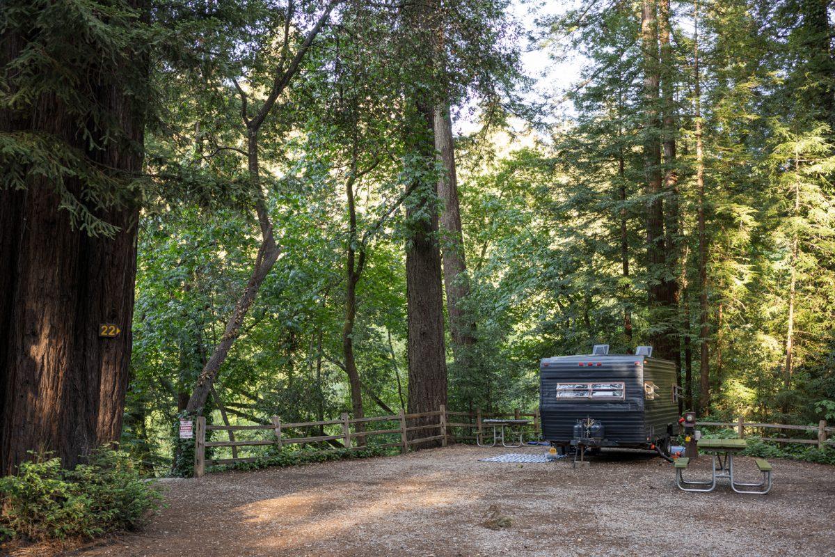 Redwood trees encircle a campsite at the Santa Cruz Redwoods RV Resort in Felton, California.