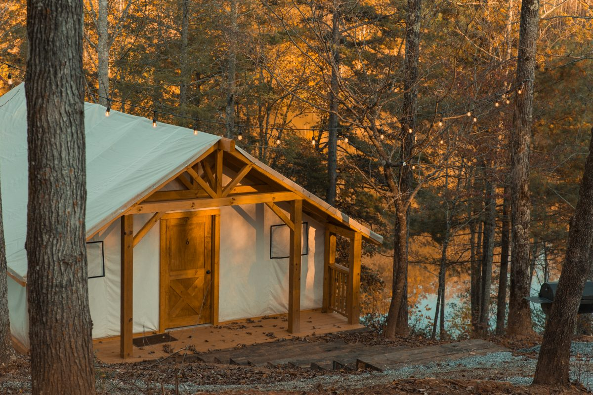 A glamping cabin surrounded by the golden fall leaves at Yogi Bear's Jellystone Park Camp-Resort: Golden Valley in Bostic, North Carolina.