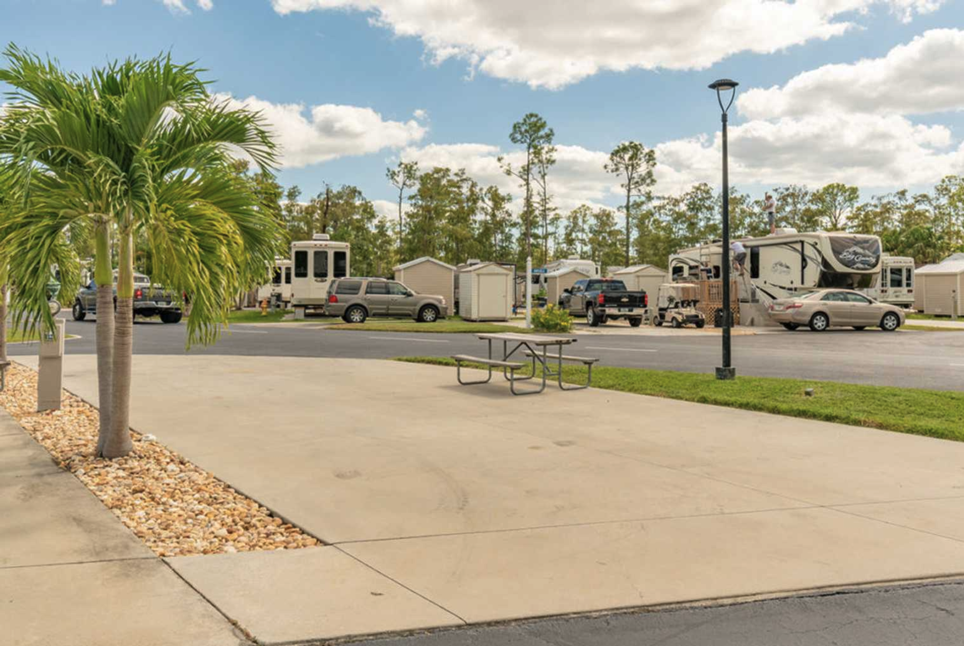 An RV site at Club Naples RV Resort in Naples, Florida
