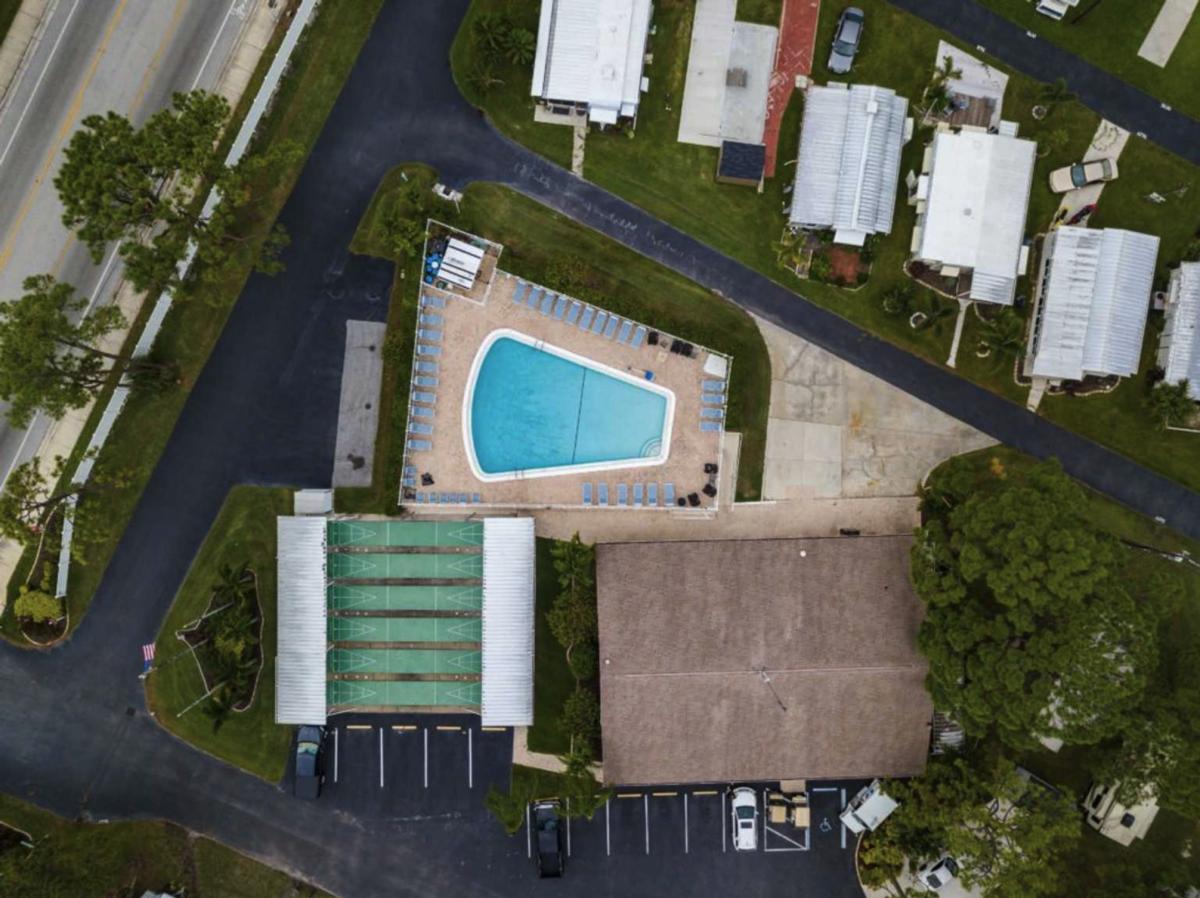 Pool and shuffle board area of Arbor Terrace RV Resort in Bradenton, Florida