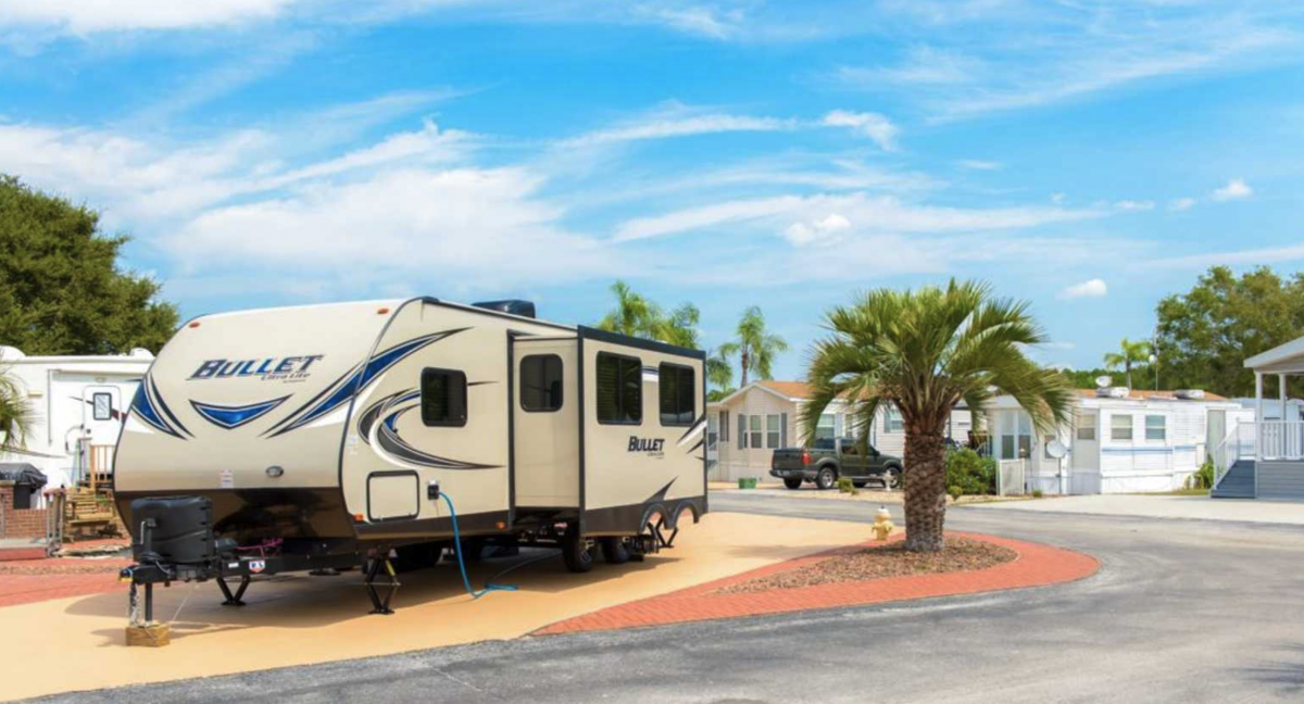 An RV parked in an RV site at Three Lakes RV Resort in Hudson, Florida