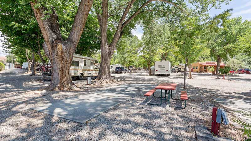 An empty RV site in the Canyonlands RV Resort & Campground in Moab, Utah.