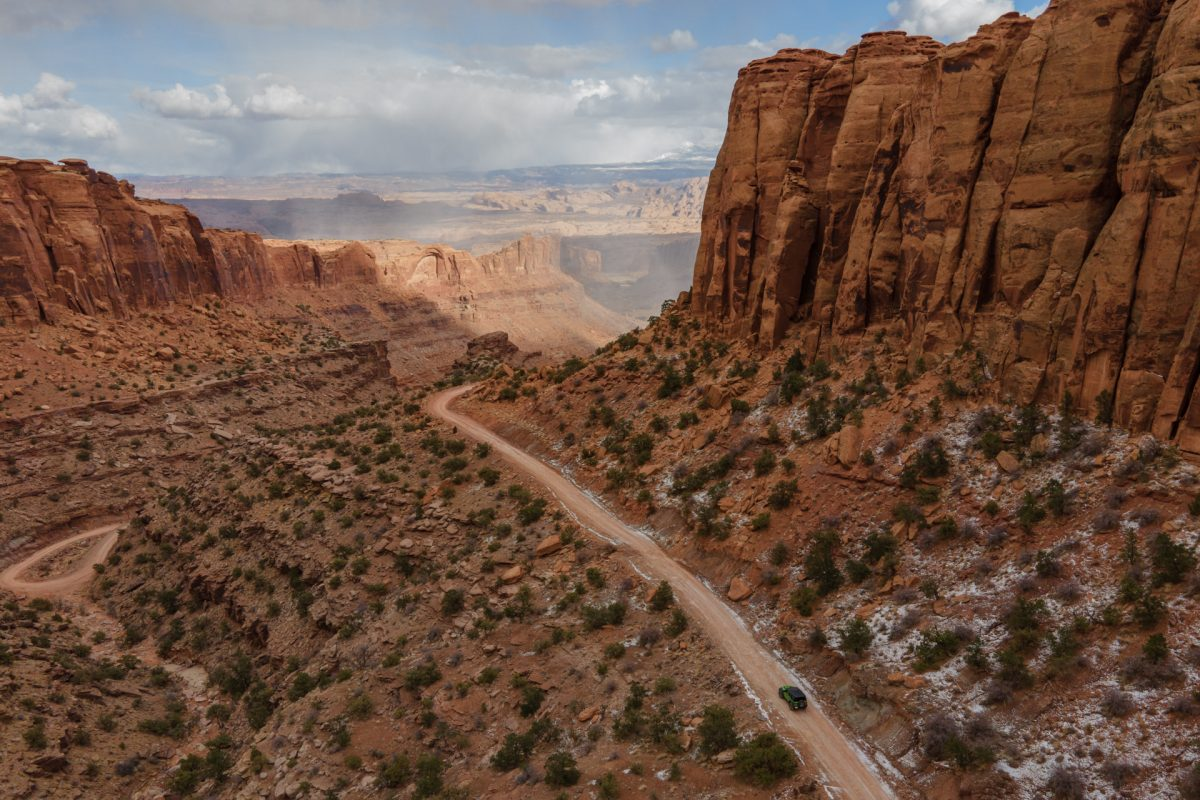 A jeep trailing down a red rock canyon in Moab, Utah.